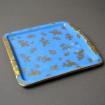 Vide-poche cendrier plat à fleurs or sur fond bleu