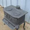 Small GAUDIN wood stove in black cast iron in toad style
