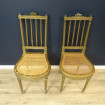 Pair of Louis XVI chairs in gilded wood and caned