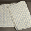 Baby blanket in blue and white knitted wool