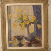 Bouquet of yellow tulips on framed cardboard